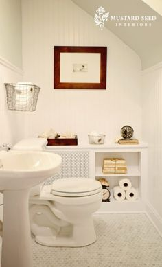 Benjamin Moore Gray Owl source: Mustard Seed Interiors Sweet bathroom design with soft gray walls paint color, chair rail with beadboard backsplash, vintage wire baskets, marble hex tiles floor, white lattice radiator cover and glossy white pedestal sink. Upstairs Bathrooms, Downstairs Bathroom, Small Bathroom, Bathroom Storage, White Bathroom, Bathroom Radiators, Bathroom Renos, Bathroom Ideas, Bathroom Renovations