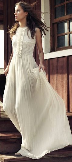 I know its plain, but its pretty and would make a great wedding dress (open hole on the back)