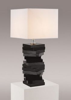 The timeless elegance of this lamp is sure to lend a special atmosphere anywhere its placed! **Shade included**