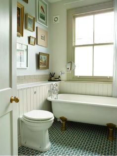 Claw foot antique bath, linen curtains, henley cool tiles, windows painted in Hardwick White by Farrow & Ball. Gallery wall of vintage prints with tongue & groove panelling. Interior Design and sourcing by imperfectinteriors.co.uk Photograph by Rachael Smith