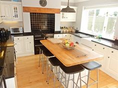 The modern, fitted kitchen with island, granite worktops, belfast sink and range cooker!