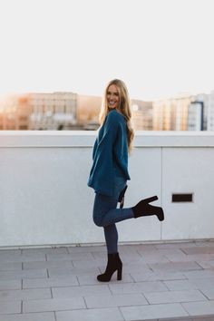 Bell sleeve sweater with jeans and black suede booties