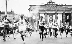 1936 Olympic Torch Relay at Berlin's Brandenburg Gate Berlin Olympics 1936, Olympic Flame, Kaiser Wilhelm, Modern Games, Brandenburg Gate, Olympic Committee, Popular Sports, Berlin, Special Forces
