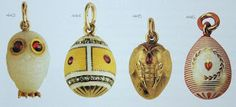 A group of 4 small Faberge egg pendants.
