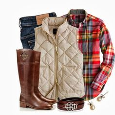 Plaid shirt, jeans, vest, boots.
