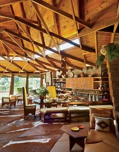 Frank Lloyd Wright 'Fir house' in Pecos, NM Beautiful wooden ceilings, cow skin rugs and yellow chairs.