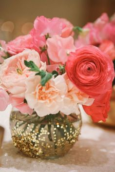 pink ranunculus and peonies in a glitter vase