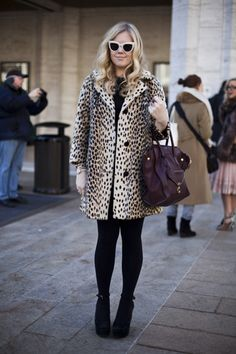 A leopard coat and a retro shades caught this photographers eye outside of Lincoln Center.