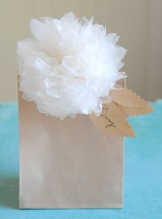 DiY WaXeD PaPeR PoM PoM FLoWeRS To DeCoRaTe GiFT BaGS WiTH. i MaDe MuCH LaRGeR VeRSioNS oF THeSe To HaNG aT My BRiDaL SHoWeR, BuT THeSe MiNiS WouLD Be SuCH CuTe DeCoR oN GiFTS