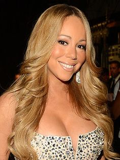 Get this.... Mariah Carey in 'Serious Talks' To Be American Idol Judge - Perhaps then I will watch the show.