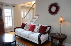 White couch with wood area in living room area.