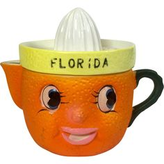 Citrus Face Orange Juice Reamer oh how I would love this for my Daughter for her kitchen in Fl.