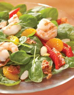 Mandarin Shrimp Salad 1 pkg Fresh Express® Baby Spinach  1 can mandarin oranges in light syrup  1/2 cup roasted red peppers, sliced  1/2 cup toasted almond slivers  4 strips of bacon, crumbled  8 grilled shrimp  Your favorite vinaigrette dressing