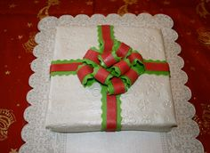 A christmas present or a cake? Or both? A cake in the form of a gift with fondant ribbon