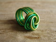 Items similar to statement ring, swirled pop coloured aluminum wire,green, lime on Etsy