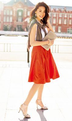 Nice summer look; White sleeveless shirt, orange flare skirt, and a spice of earth tone.