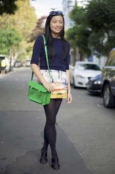 green purse and watercolor-look skirt