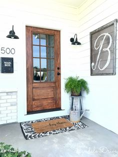 How I made our metal door look like wood – Lyndale Drive – farmhouse front door with screen Wood Front Doors, Front Door Decor, Front Door Lighting, Front French Doors, Front Door Initial, Front Door With Screen, Wood Garage Doors, Stained Front Door, Farmhouse Front Porches