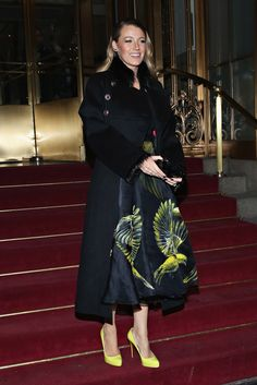 Blake Lively wearing Chanel Pre-Fall 2010 Coat, Marchesa Spring 2015 Printed Full Skirt, Christian Louboutin Rolando Pumps in Yellow and Gucci Aristographic Black Plexiglass Evening Clutch