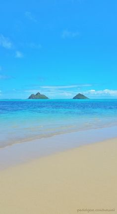 View of Mokulua Islands, as seen from Lanikai Beach, Hawaii, named one of the best beaches in the world by TripAdvisor