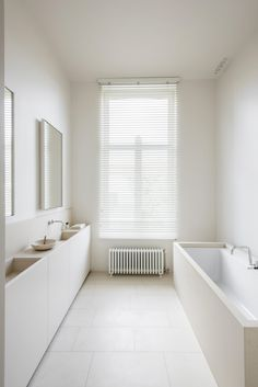 Keep it simple and use white limestone to create a beautiful, tranquil bathroom.