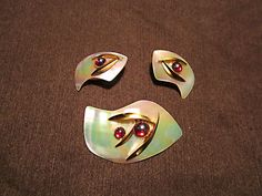 Vintage made in west Germany mother of pearl brooch set with clip on earrings.