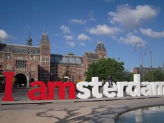 Take my picture inside the I amsterdam sign in the Museumplein.