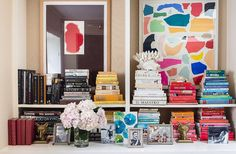 One way to style your bookshelf, arrange your books according to color. KATE VESPA || design & style