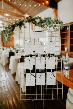 Table assignment gold and eucalyptus. Beautiful wedding table assignment with greenery.