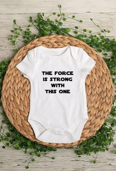 The Force is Strong With This One Baby Bodysuit or Toddler Tee. *Bodysuits are Carter's brand. Please see their sizing chart if you aren't sure what size to order. *All bodysuits are white. The color you choose is for the text/image. *If you would like a colored bodysuit, please request a custom