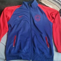 Women's Chicago Cubs Nike Jacket Brand New without the tags.  Size: xxl but does not fit perfect to size because I am a L/XL and it fits me just right Original price: $70.00 Nike Sweaters