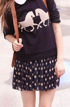 Just perfect. Dark navy, polka dot pleated skirt, and that adorable sweater print.