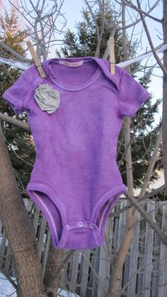 Hand dyed purple onesie with grey t-shirt flower and Peek-a-poo back. $12.00, via Etsy.