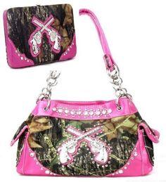 Western Pistol Gun Pink Camouflage Rhinestone Handbag W Matching Wallet. Beautiful matching purse and wallet set. Purse Size: 13(L) X 8.5(H) X 4.5(W). Wallet Size: 7.5(L) X 4.5(H) X 1(W). Feel leather. Beautiful Pink Trim with Rhinestone Accents.