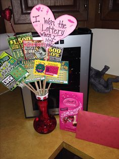 Valentines day gift for your man! Fill vase with chocolates and use lottery ticket as bouquet !!