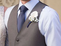 Boutonniere White Blue, White Calla Lily Boutonniere with white baby's breath and navy blue ribbon.