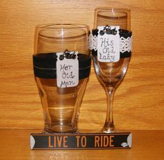 Personalized Champagne Flute and Beer by CarolesWeddingWhimsy, This set of Motorcycle Wedding Toasting Champagne Flute and Pilsner Glass are fabulous are trimmed in your choice of black leather or black suede.  They have a silver tag that you can personalize and are trimmed with black metal motorcycles.  You can find them here https://www.etsy.com/listing/259467406/personalized-champagne-flute-and-beer