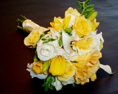 white calla lily wedding bouquet yellow accent | the toss bouquet a smaller version of the bride s