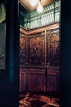 the elevator inside the 72-room mansion at the corner of bowery and spring street