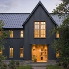 Grey House With Black Roof. Exterior house colors with black roof, charcoal grey houses with metal roof. Grey house with red door. Dark Grey Houses, Dark House, Metal Building Homes, Building A House, Building Ideas, Metal Homes, Modern Farmhouse Exterior, Farmhouse Style, American Farmhouse
