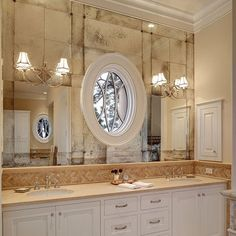 This an amazing use of Antique Mirror! Regular mirrors were placed in your viewing area over the sink with antique mirror covering the rest of the wall. MirrorGlassDesign.com