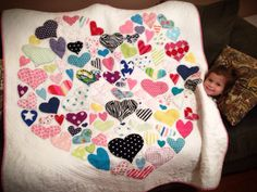 I made this quilt for this precious little girl out of her own clothing. It measures 54 x 54. I machine quilted all over. The batting is 80/20 cotton/poly. I hope she enjoys it for years to come.