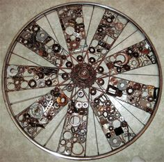 The Cycle of Life from recycled metal by Deborah Norsworth