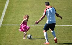 Netherlands' forward Robin van Persie plays with his daughter after a training session at the Flamengo Stadium in Rio de Janeiro