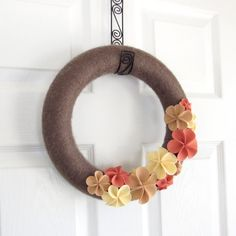 Hey, I found this really awesome Etsy listing at http://www.etsy.com/listing/98160952/spring-yarn-wreath-neutrals-taupe-coral