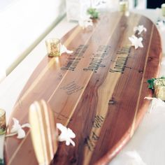 Wooden surfboard guestbook for the Bride and Groom to hang in their home // Wendy Laurel Photography