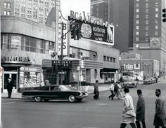 The old Greyhound Station and Cunninghams Drug Store with the Statler Hotel in the background. Detroit, Michigan 1960