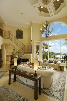 Love the enormous wall of windows, ceiling and furnishings in this wonderful living room.