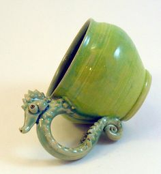 Who wouldn't want a seahorse wrapped around their hand every morning? Mug.