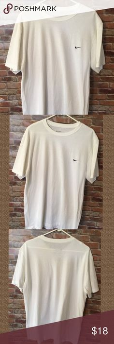 HOST PICK....White Nike T-Shirt White Nike T-Shirt , short sleeve, with black nike emblem on the front... Nike Shirts Tees - Short Sleeve
